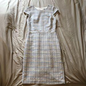 Baby blue and white sheath dress.